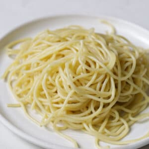 cooked pasta on a white plate