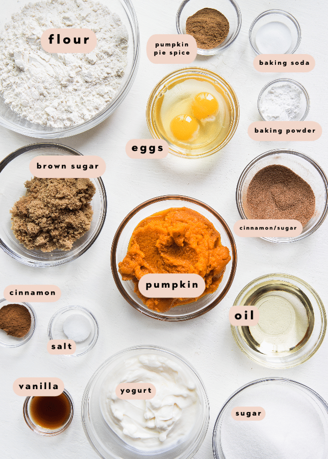 all of the ingredients needed for pumpkin muffins in glass bowls