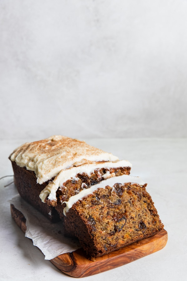 carrot cake bread with cream cheese frosting on top