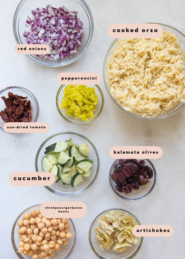 ingredients needed to make orzo salad in glass bowls