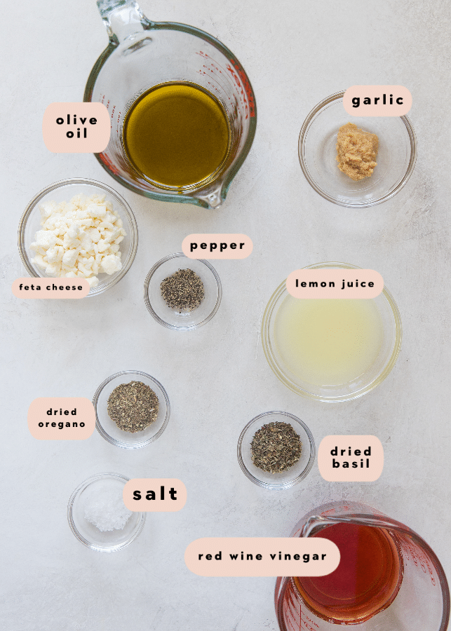 ingredients needed to make greek dressing in glass bowls