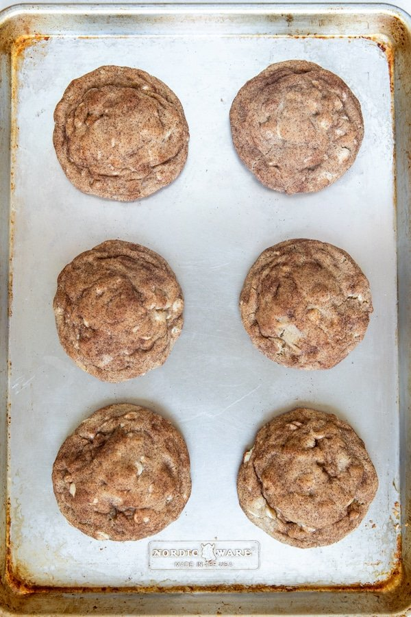 freshly baked chewy snickerdoodle cookies on a baking sheet