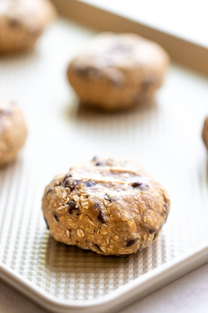 oatmeal chocolate chip cookies on a baking sheet