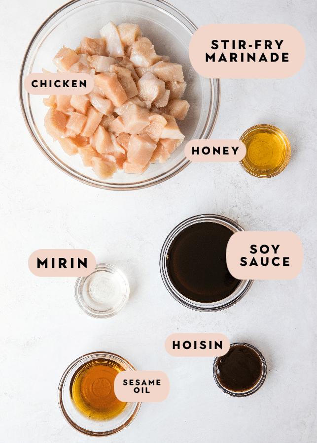 cashew chicken stir fry ingredients in small glass bowls