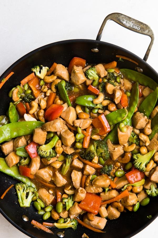 cashew chicken stir fry in a wok