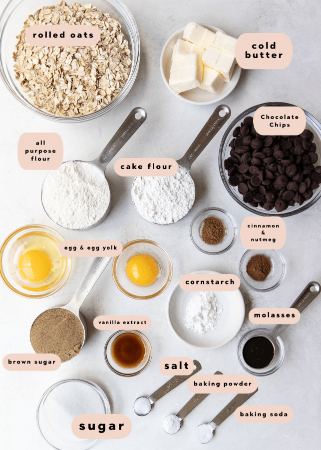 all of the ingredients needed in measuring cups, spoons and bowls for oatmeal chocolate chip cookies