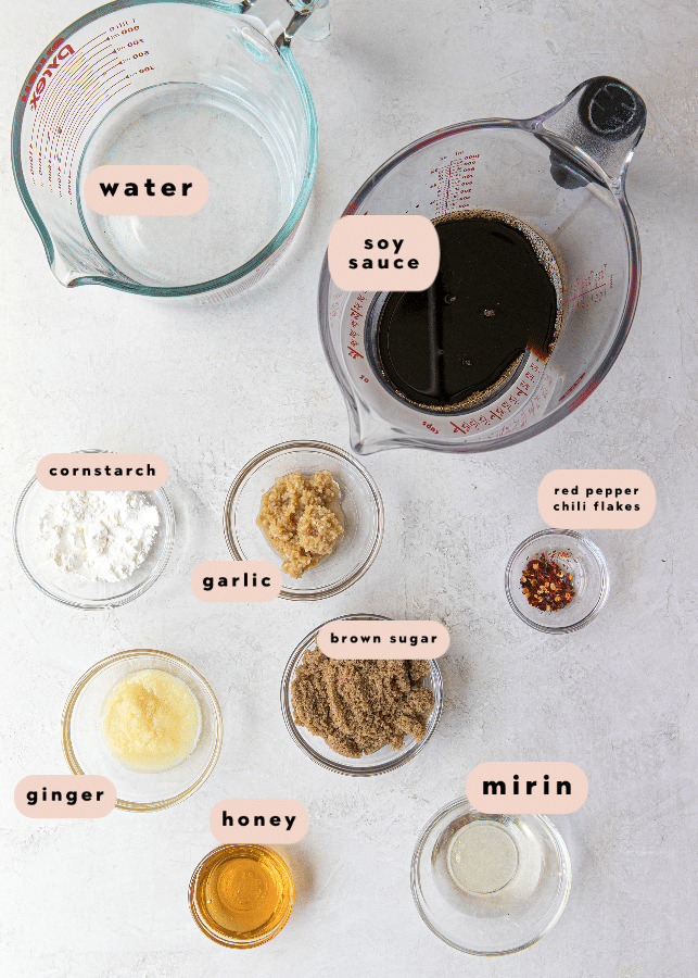 ingredients needed for teriyaki salmon in small glass bowls.