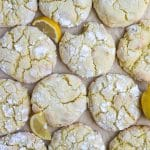 lemon crinkle cookies on parchment paper