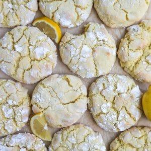 lemon crinkle cookies on parchment paper