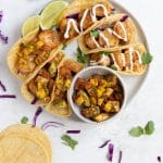 shrimp tacos on a white plate
