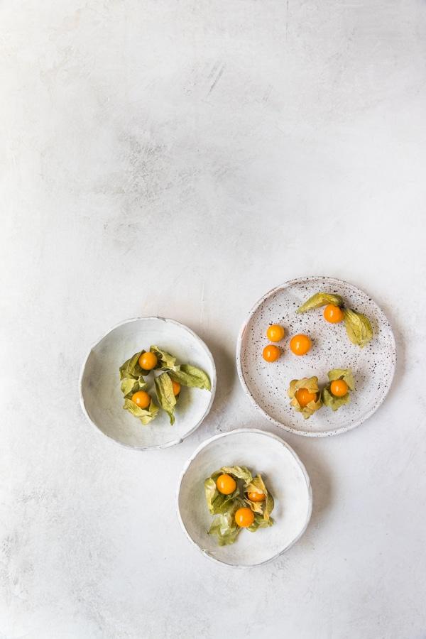 golden berries on plates