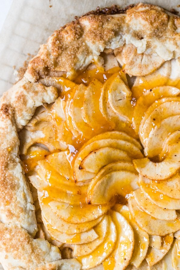 an apple galette on parchment paper