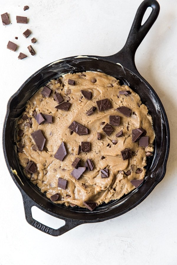 a cookie in a cast iron skillet