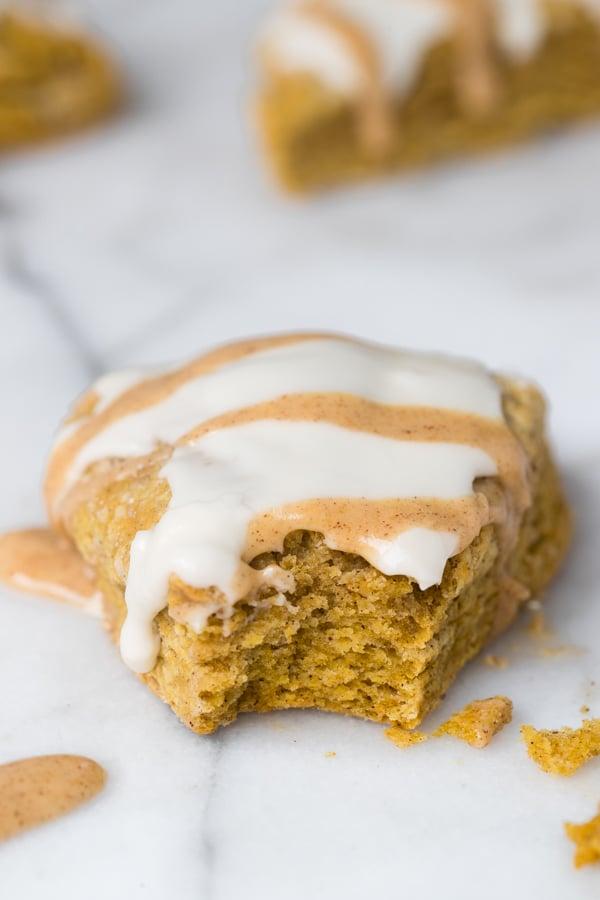 a bite taken out of a pumpkin scone