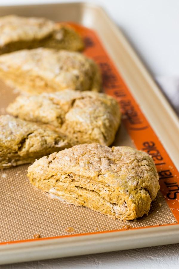 pumpkin scones on a baking sheet
