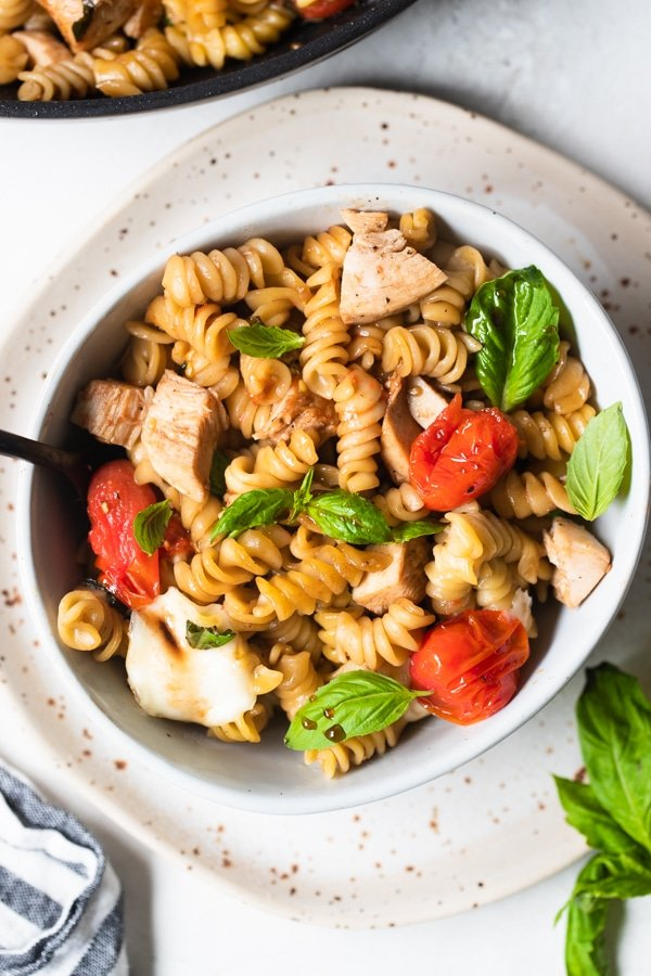 Caprese Pasta in a white bowl