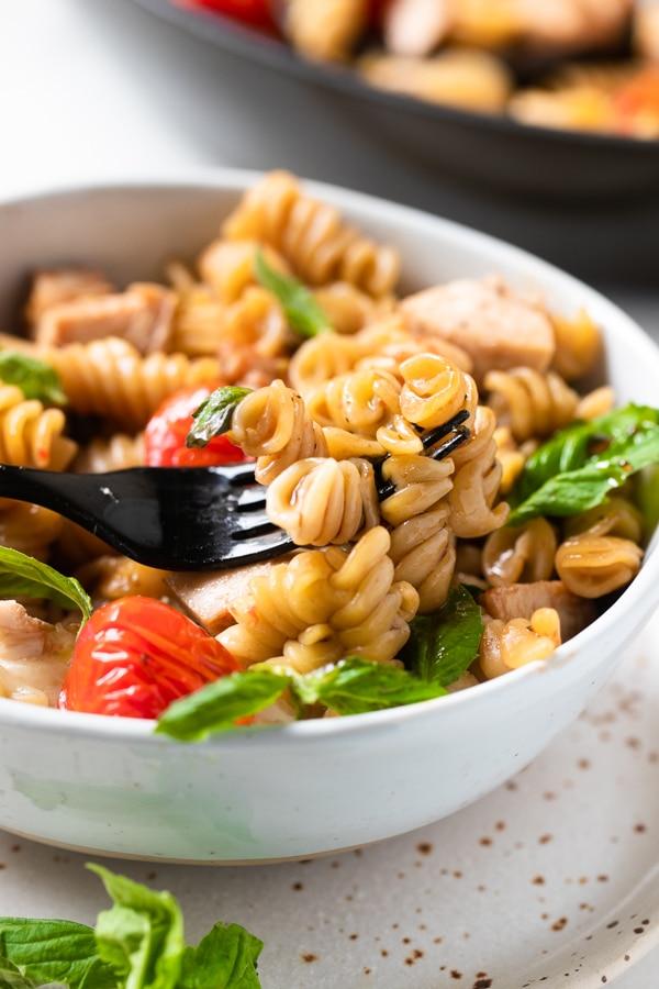 Caprese Pasta in a white bowl
