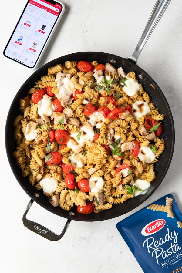 Chicken Caprese Pasta in a frying pan