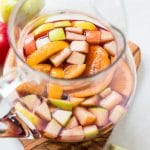 fall sangria in a glass pitcher