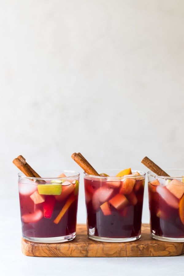 Fall sangria in glasses with a cinnamon stick