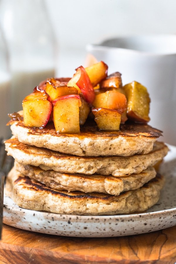 pancakes on a plate with apples on top
