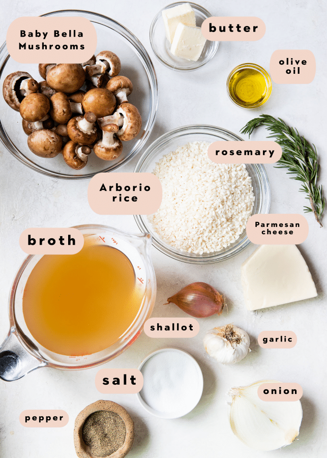 ingredients on a white board needed to make risotto with mushrooms