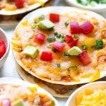 mexican pizza topped with tomatoes and avocado