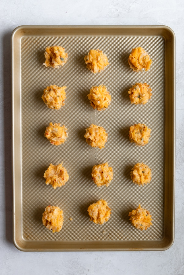 phyllo cups filled with butternut squash on a baking sheet