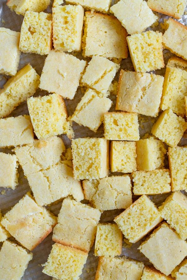 cornbread on a baking sheet cut into cubes