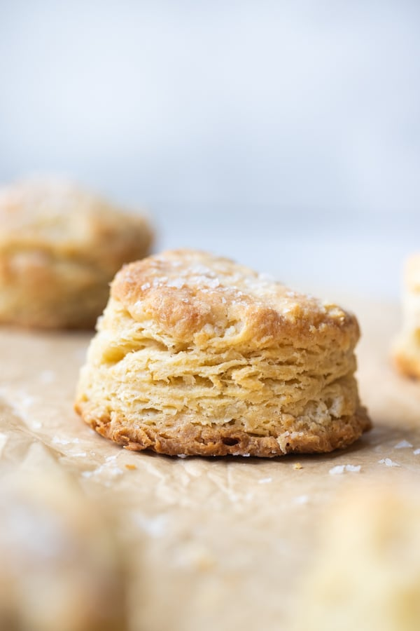 a biscuit on parchment paper with flaky sea salt on top