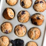 freshly baked blackberry muffins in a muffin tin