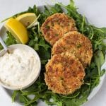crab cakes on a bed of arugula