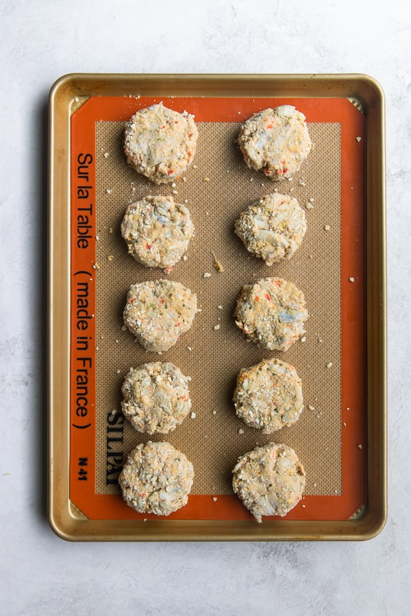 crab cakes on a baking sheet