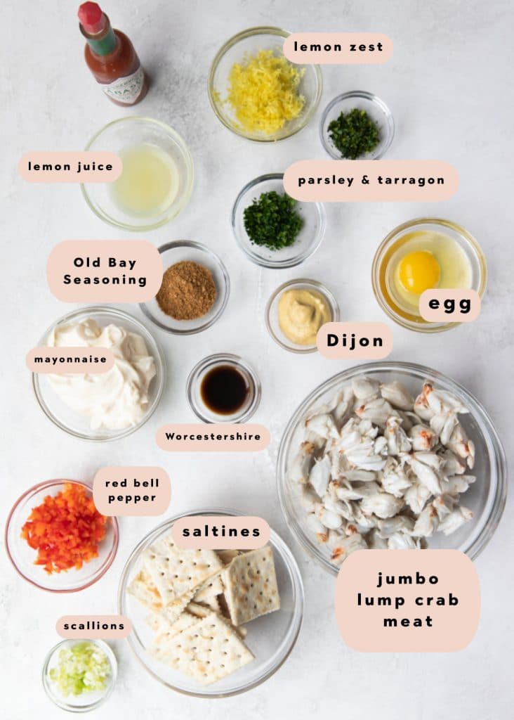 ingredients needed to make crab cakes divided into small bowls
