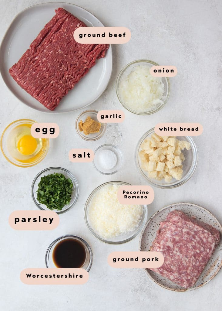 ingredients in small glass bowls needed to make meatballs