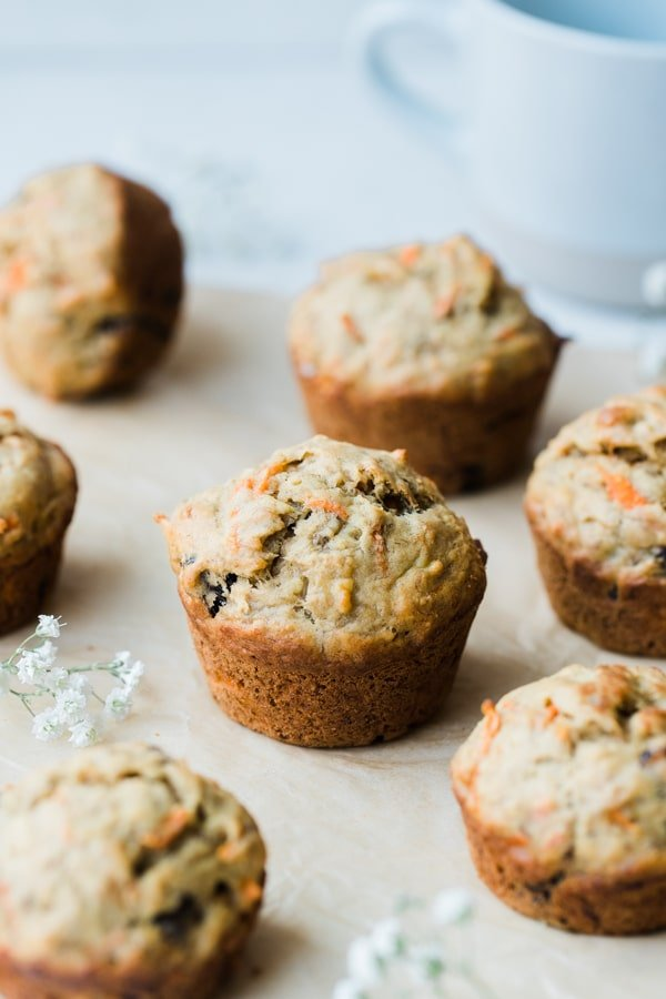 banana carrot muffins on parchment paper