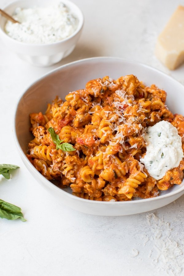 rotini pasta made with ground turkey in a white bowl