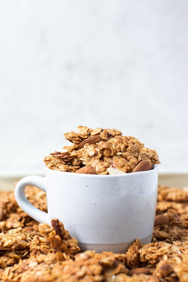 granola in a white mug