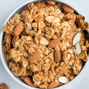 granola in a white bowl with almonds