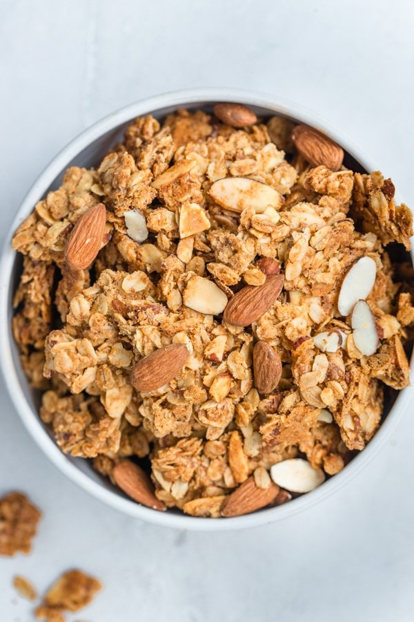 granola in a white bowl with almonds