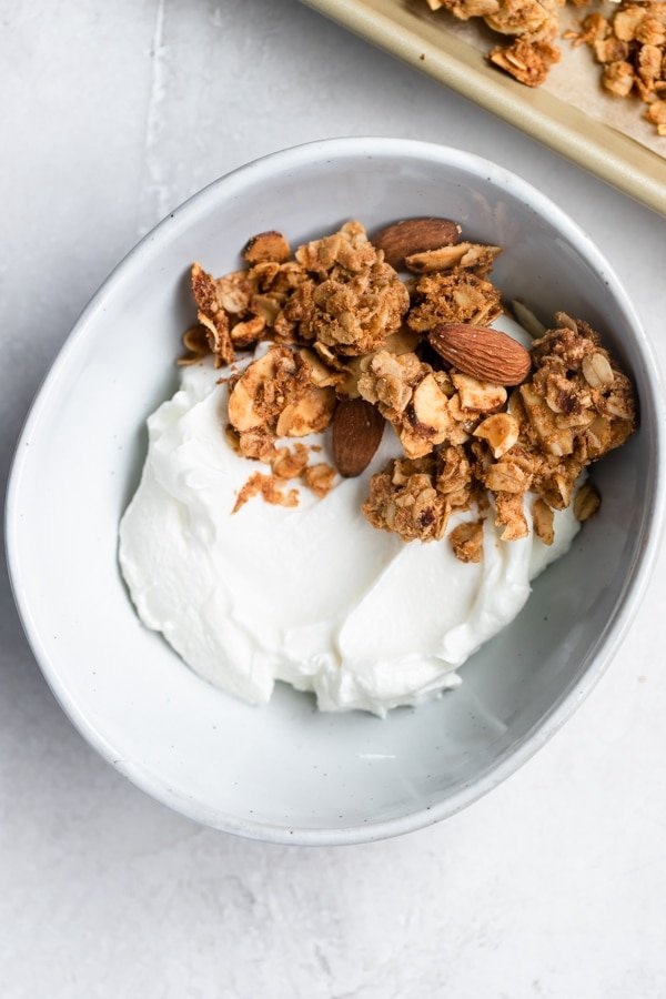 granola and yogurt in a white bowl