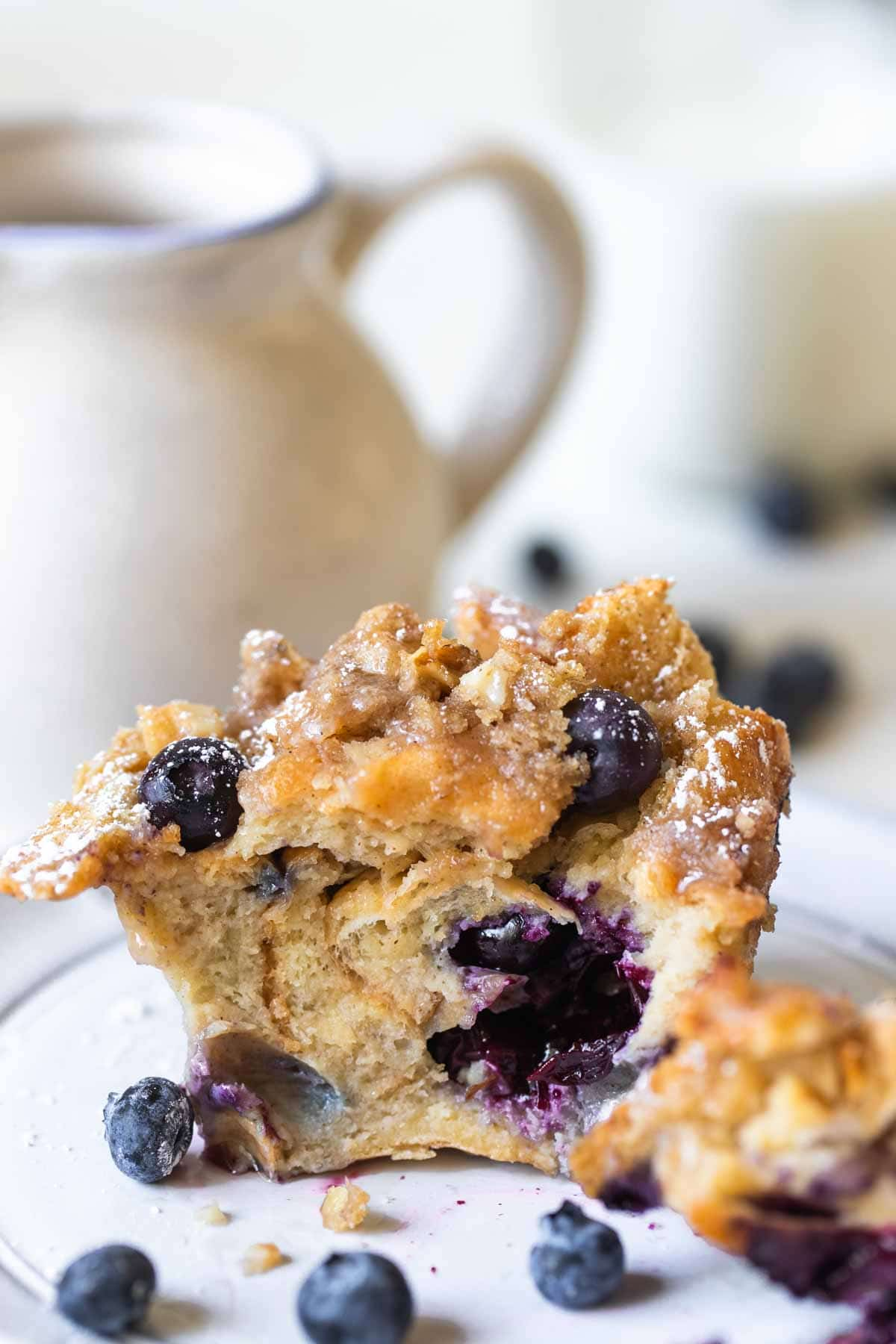 blueberry muffin on a white plate
