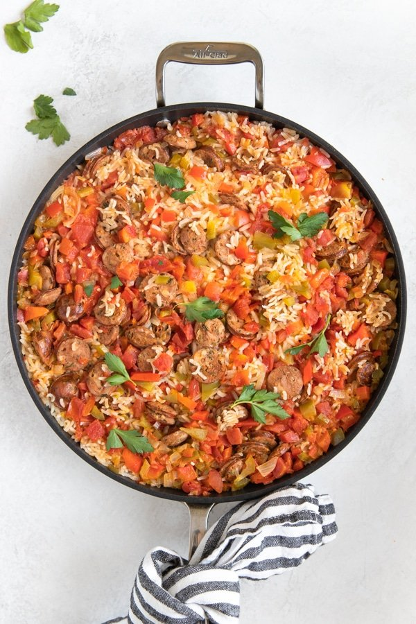 Sausage, Peppers and Rice in a large nonstick skillet topped with parsley