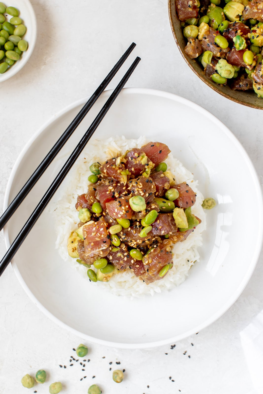ahi poke in a white bowl with white rice
