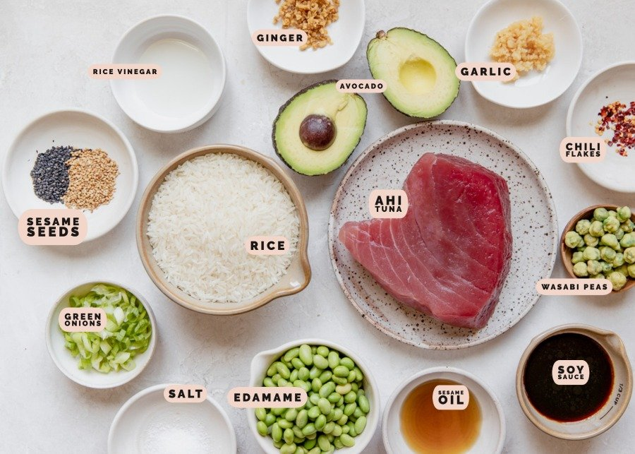 ingredients to make poke bowls in small dishes
