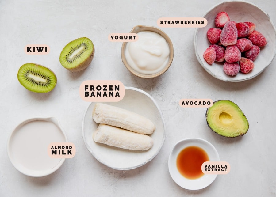 ingredients in small bowls needed to make a smoothie