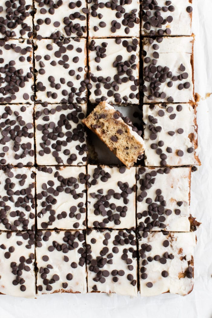 banana bars on parchment paper covered in mini chocolate chips