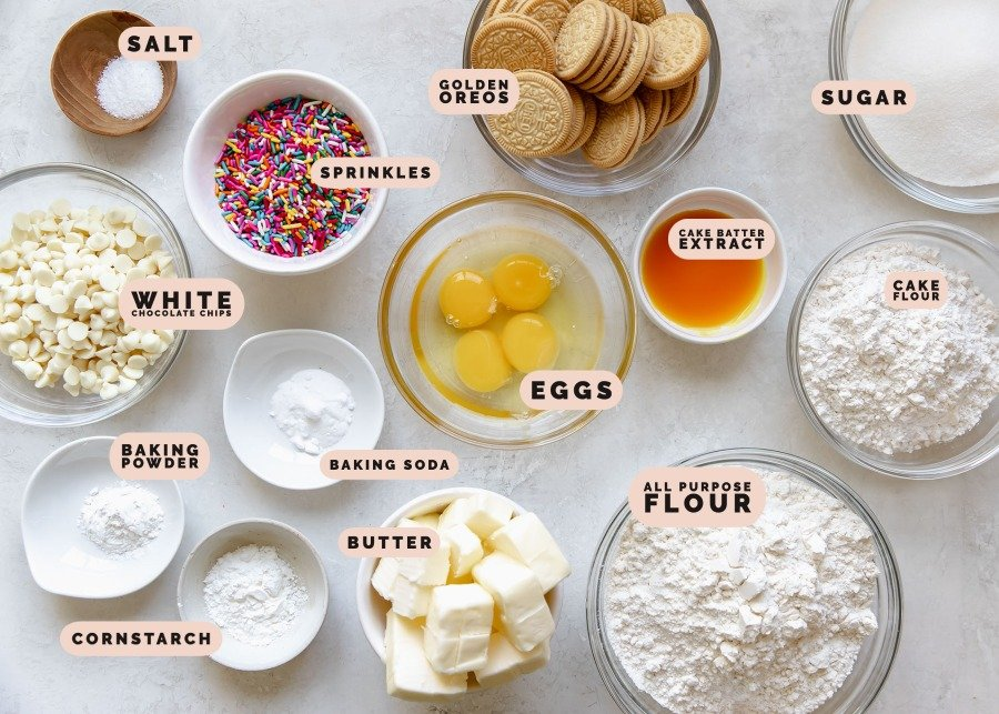 ingredients needed to make cookie bars in small glass bowls and dishes