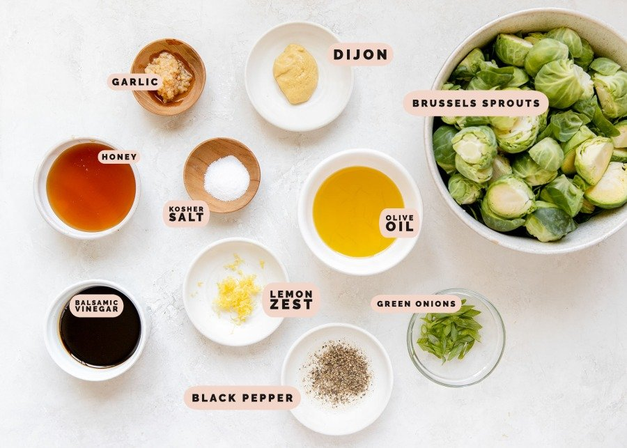 ingredients needed to make roasted brussels in small white bowls