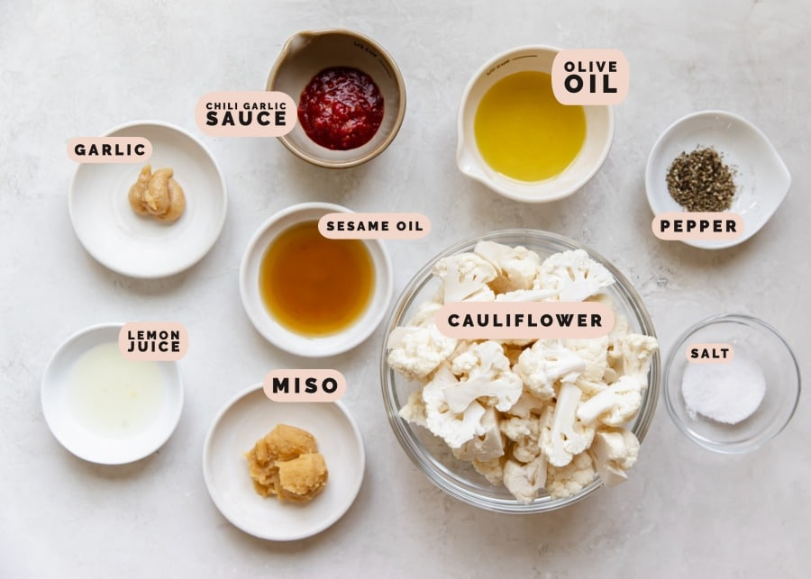 ingredients to make roasted cauliflower in small glass bowls